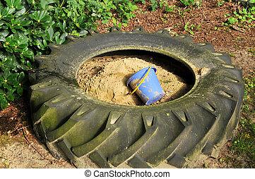 sandbox - blue child bucket in a sandbox