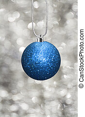 Blue christmas ball on a string