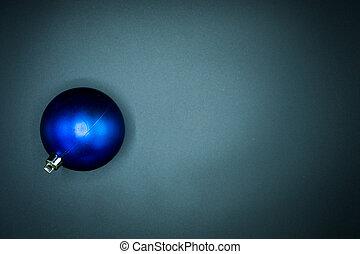 Blue christmas ball on black background.