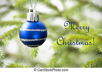 Blue Christmas Ball on Christmas Tree with Text Merry Christmas