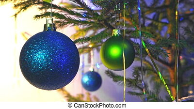 Blue christmas ball on new year tree