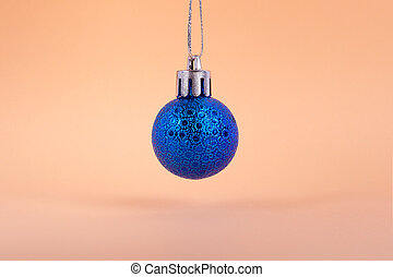 blue christmas ball toy on a beige background