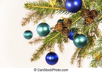 blue christmas balls on a branch