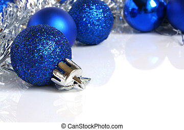 Blue christmas balls on a white background