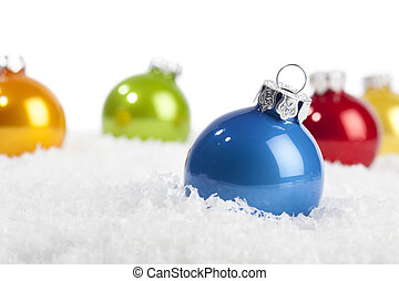 Blue Christmas bauble in decorative snow