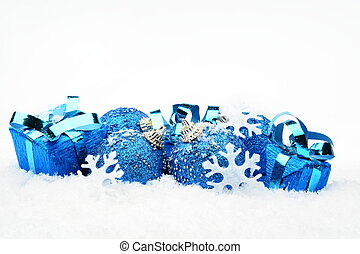 Blue christmas decoration on snow