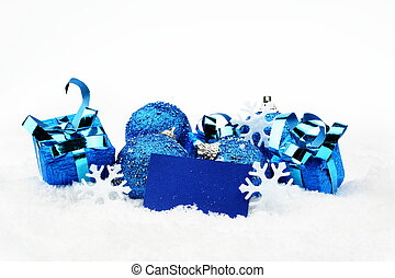 Blue christmas decoration with wishes card on snow