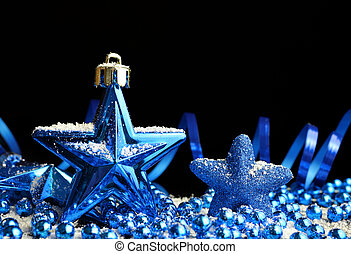 Blue Christmas decorations in the shape star.