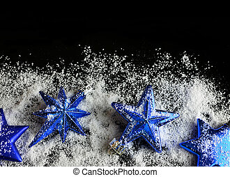 Blue Christmas decorations in the shape star with snow.