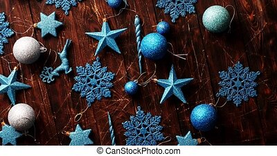 Blue Christmas decorations on table - From above shot of...
