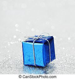 Christmas gift - Blue Christmas gift box on shiny silver...
