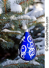 blue Christmas ornament on pine