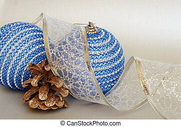 Blue christmass balls with tape and pinecone