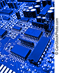 Blue circuit board elements - close up of a circuit board...
