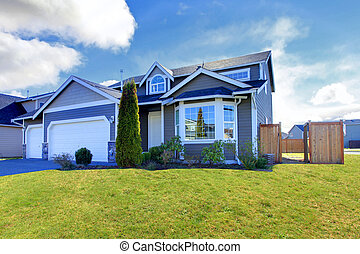 Blue classic house with tile roof