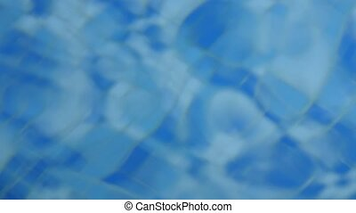 Blue clear rippled water in the swimming pool. 4K