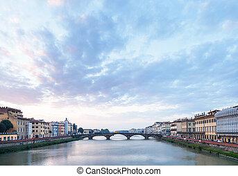 blue clouds over Arno River and Ponte alla Carraia