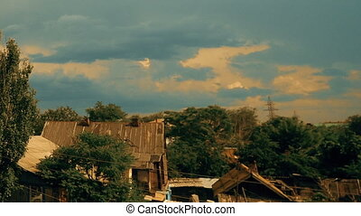 Clouds running over sky and old wooden houses - Blue Clouds...