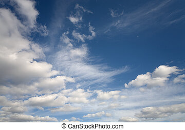 The cloudy blue spring sky