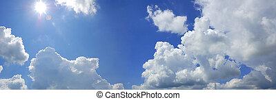 blue cloudy sky with sun panorama
