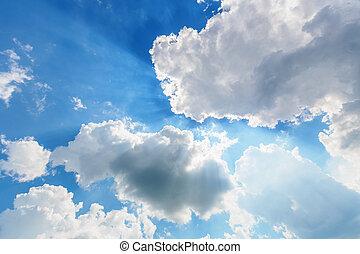 Blue cloudy sky with sun rays
