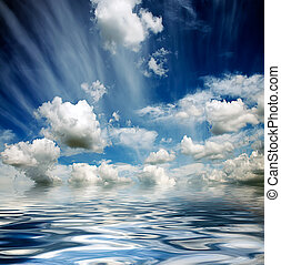 stormy sky reflected in water waves - blue cloudy stormy sky...