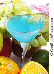 Blue cocktail among fruits