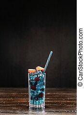 Blue cocktail and ice in a glass