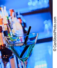 blue cocktail drink on a bar table, club atmosphere