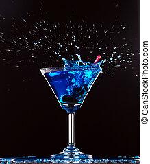 blue cocktail splashing on dark background