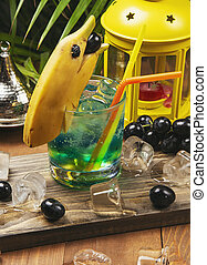 Blue cocktail with banana dolphin decoration.