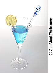 Blue cocktail with lemon slice