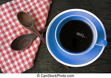 blue coffee cup on wooden background