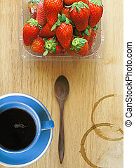 Blue coffee cup with fresh strawberries (top view)