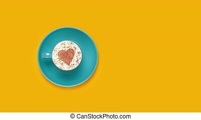 Blue coffee cup with heart shape symbol
