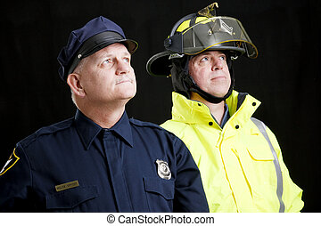 Blue Collar Heroes - Reverent looking policeman and fireman...