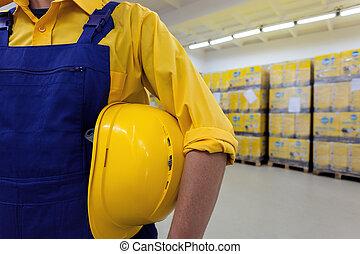 Blue collar worker - Closeup of a blue collar worker holding...