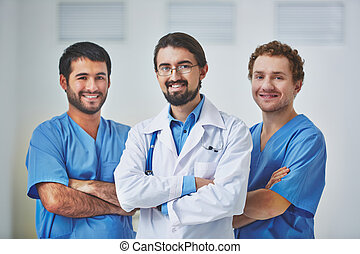 Blue collar workers - Portrait of three clinicians in...