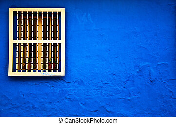 Blue Colonial Wall - A colonial styled window and wall in...