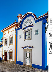 Blue color on the sky and buildings of old city Ericeira, ...