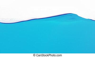 blue color water waves in aquarium slow motion