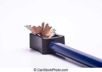 Blue coloured pencil sharpened using a sharpner