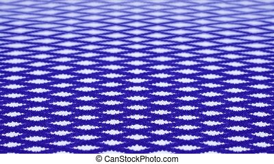 Blue coloured stripes move causing visual illusion produced by computer graphics designer in creative studio extreme closeup