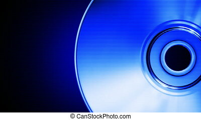 Blue compact disk - Spinning blue compact disk on a black...