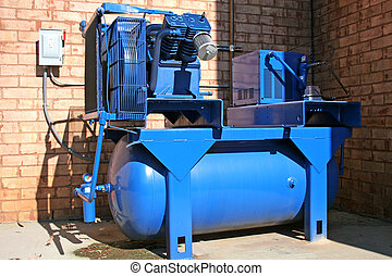 Blue Compressor - Bright blue air compressor on commercial...