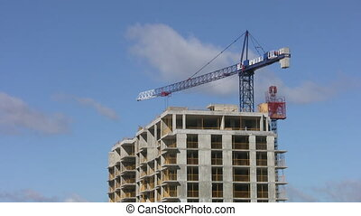 Blue construction crane. Real time. - A blue crane swings...