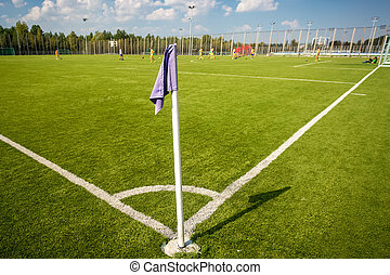 corner flag on soccer field at sunny day