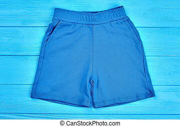 Blue cotton pocket shorts for kids.