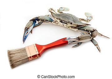 Blue crab holding a paintbrush