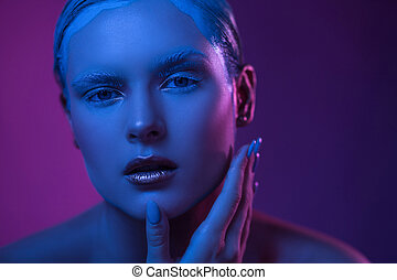 Beautiful Face in Purple Lights. Neon Lighting concept.